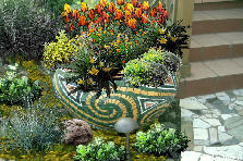 Garden design:Mosaic pot w/ orange & yellow